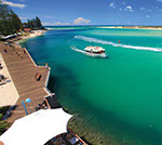 River boat on turquoise ocean at Caloundra, Sunshine Coast