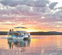 Cruise boat on Maroochy River at pink sunset