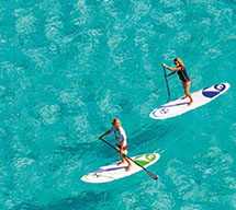 Stand up paddle boards on clear aqua ocean